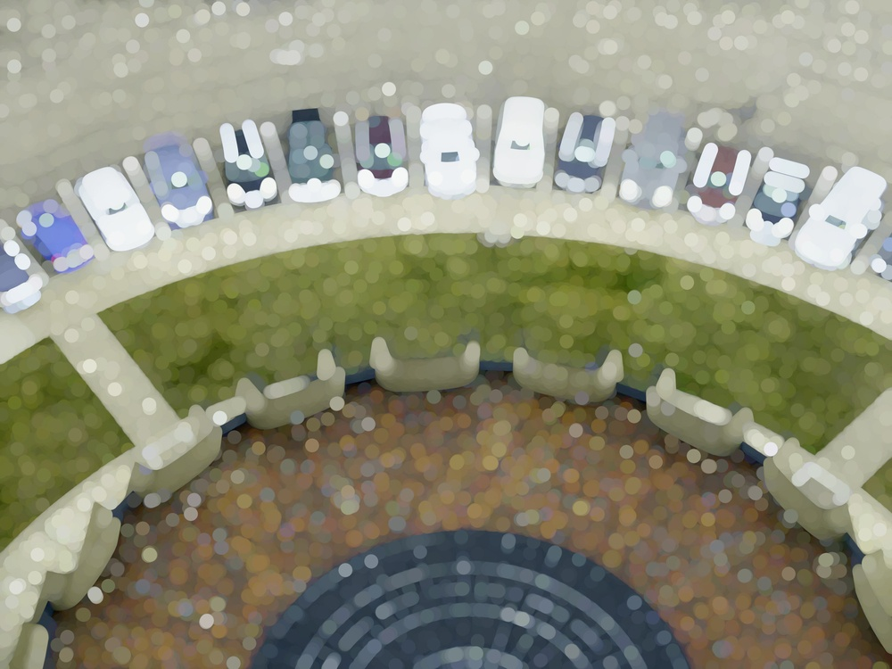 Abstract of cars parked neatly in an arc by forecourt with grass and tile, for themes of attraction, tourism, order