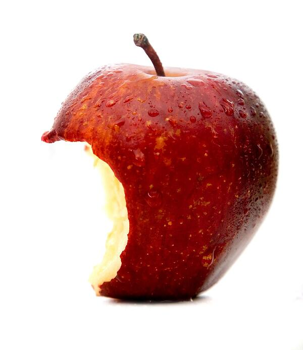apple in red half beaten isolated over a white background