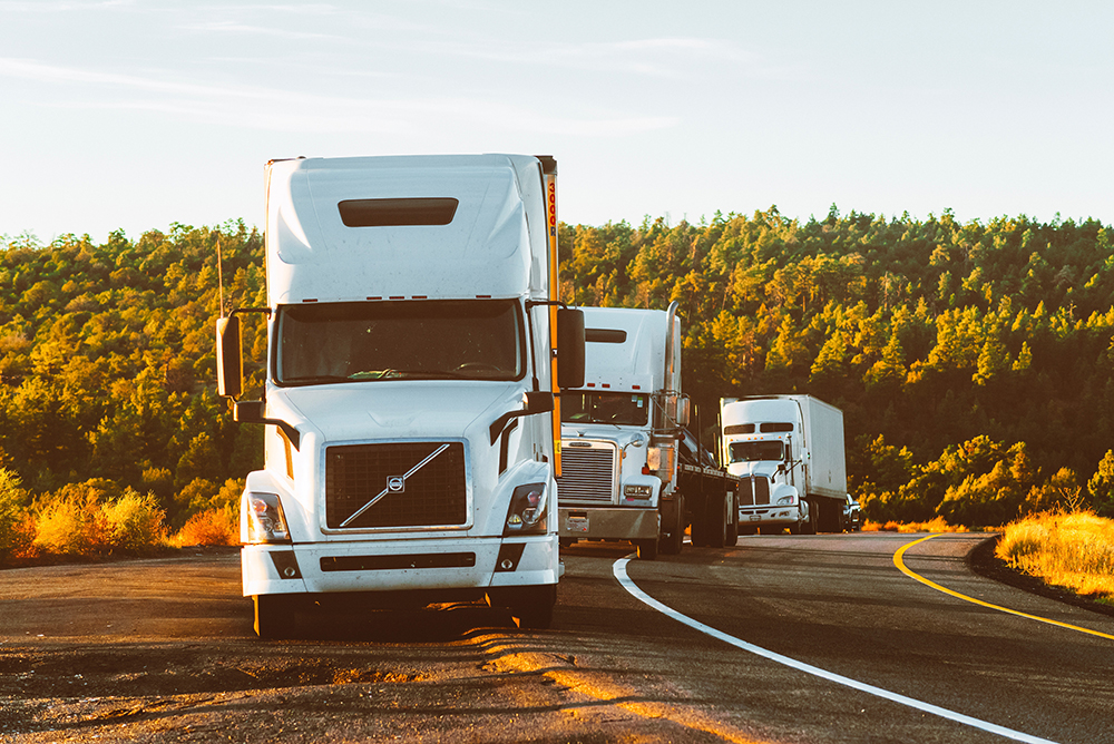 white-volvo-semi-truck-on-side-of-road-2199293-1